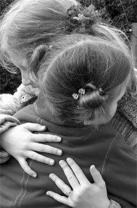 hugging sisters generic pic